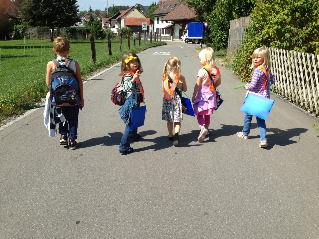 In this picture you have Kindergarten students walking together towards the main road.